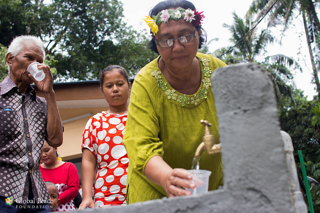 Villagers get water from new community filtered water