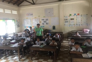 Volunteer teacher Aing in his classroom
