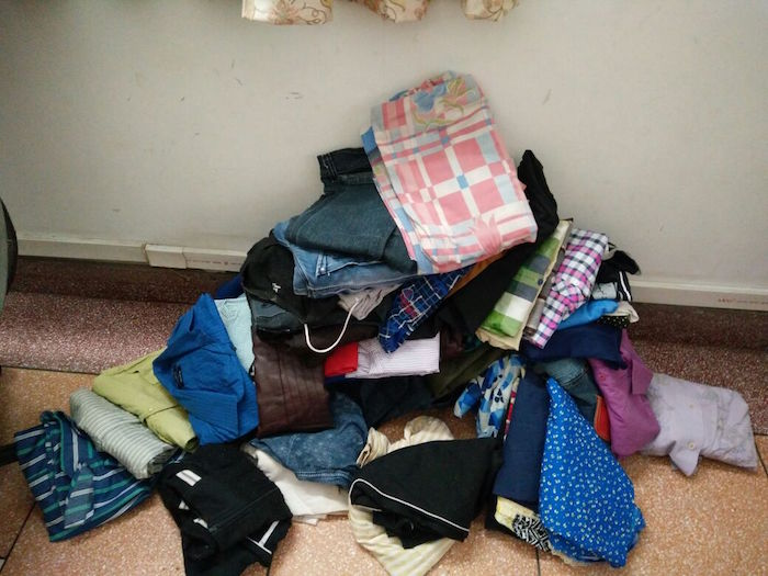 Clothes stacked from collection drive for Arya orphans