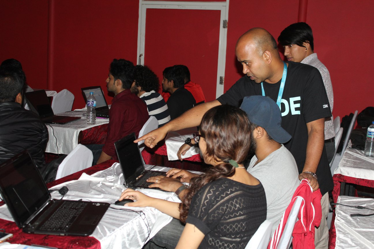 Participants work with IBM representatives and other experts in coding workshop