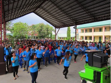 CCI Aliaga students and teachers dance at donation ceremony