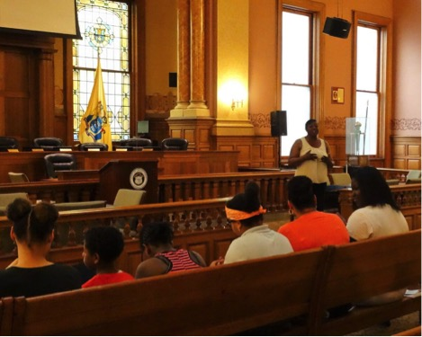 Detective Doris Johnson speaks at City Hall with JCCCE youth
