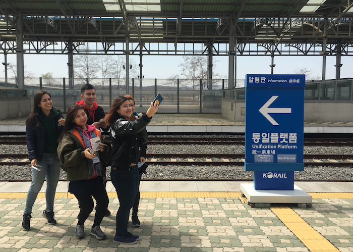 Peace Ambassadors stand on an empty platform at DMZ