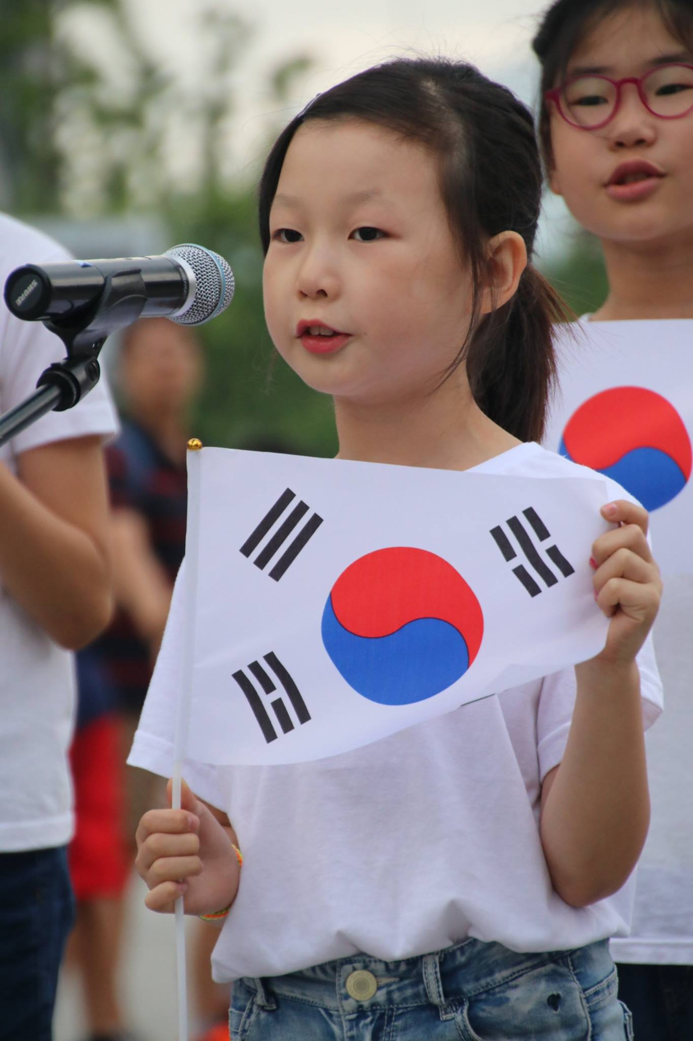 Girl holds Korean flag
