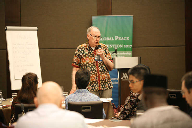 Dr. Leonard Swidler speaks at the Essentials of Peacebuilding Workshop in Manila, Philippines