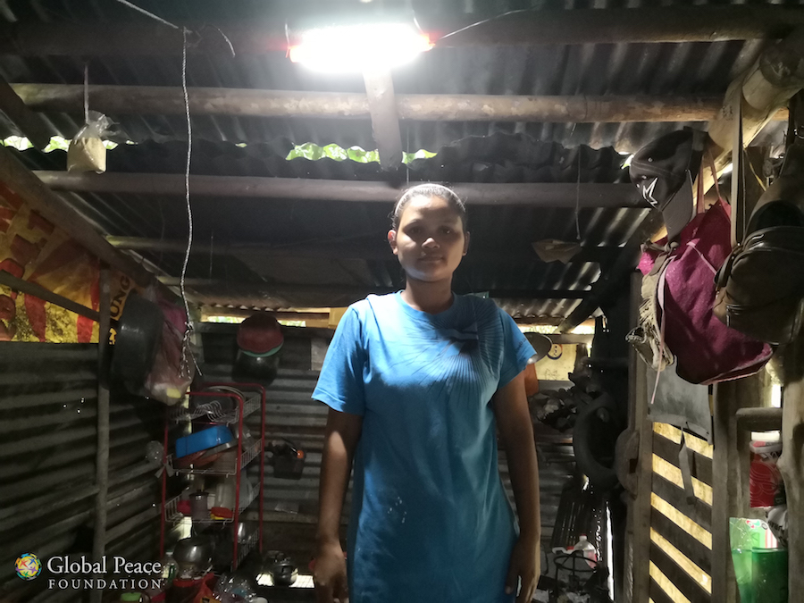 Mother stands in solar lit kitchen