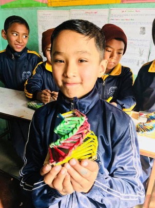 Children create upcycled crafts