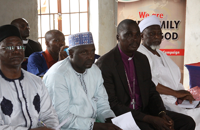 Christian and Muslim leaders sit together