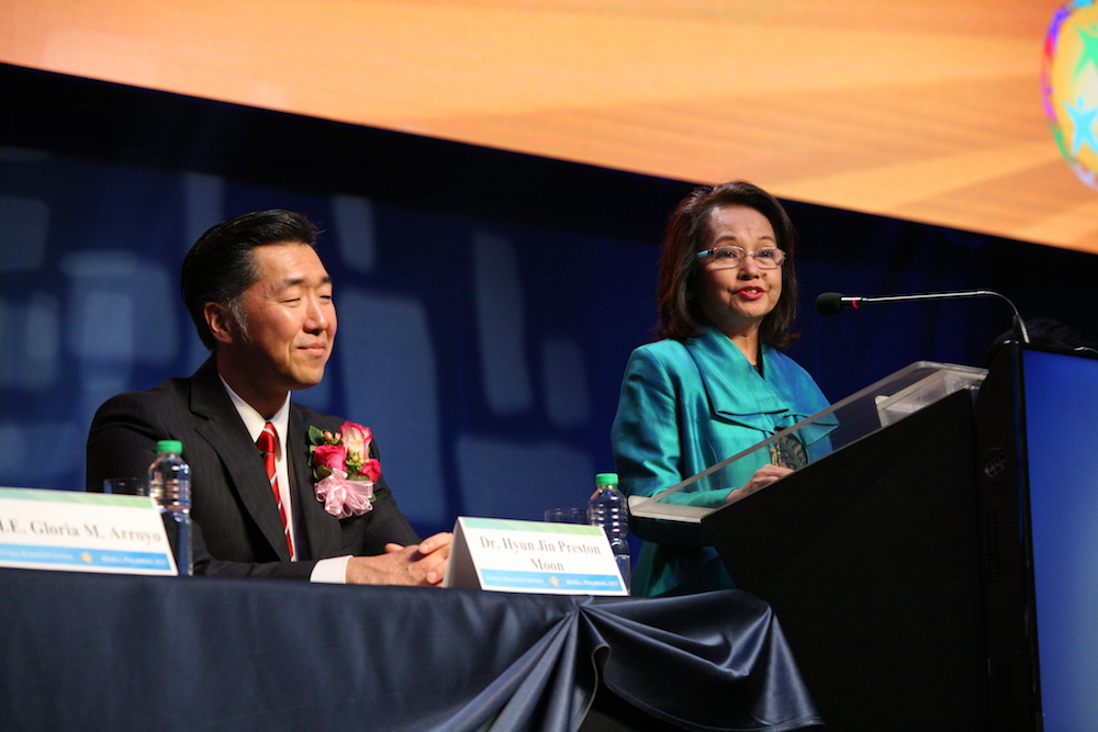 Arroyo and Chairman Moon at the opening plenary