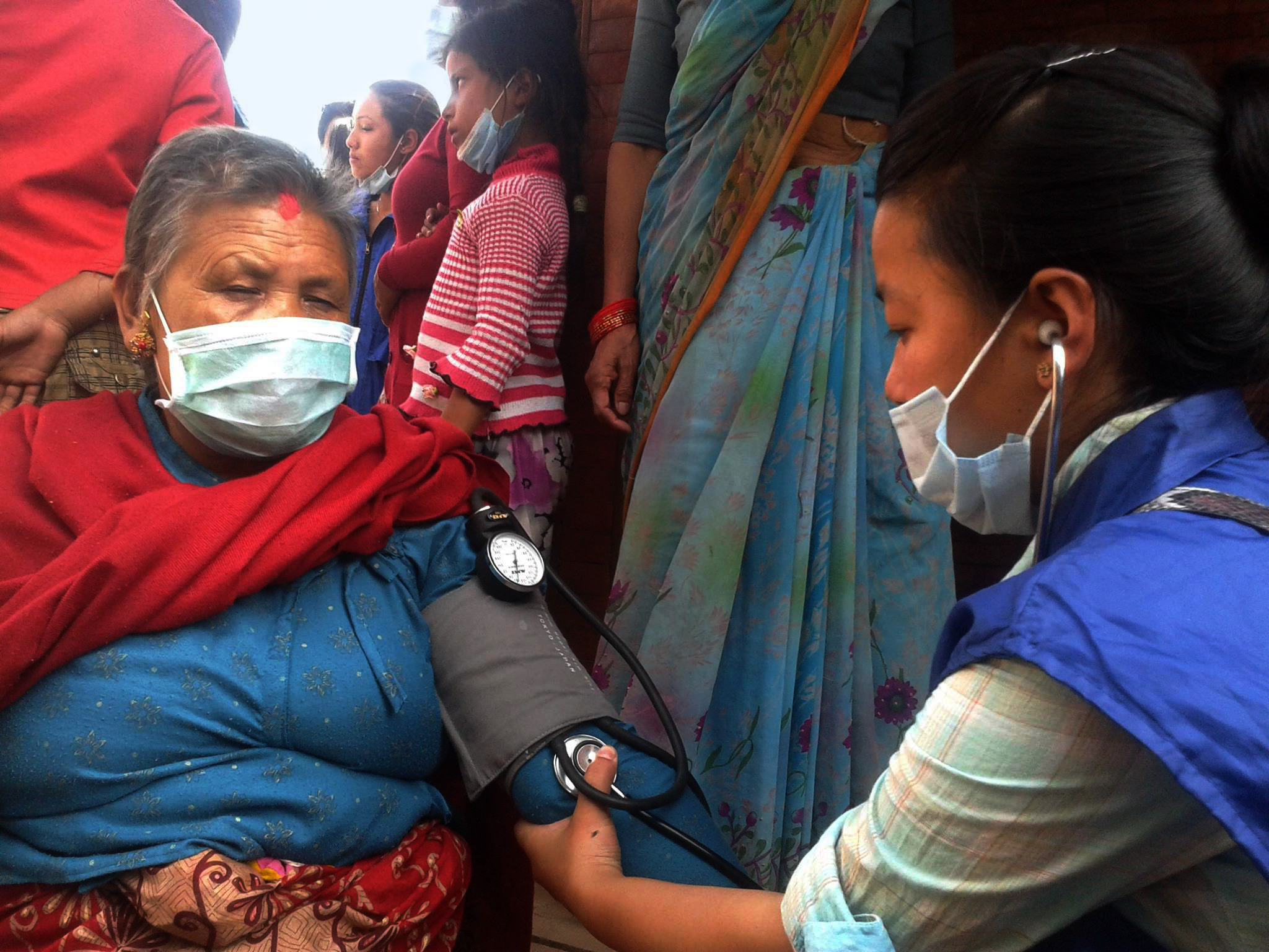 Global Peace Foundation volunteer help to nurse an old lady