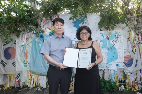 Tish Honojosa receives certificate as Honorary Ambassador for Korean reunification