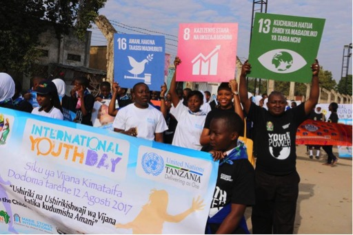 Youth hold up SDGs at Tanzania youth festival