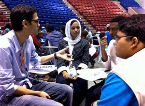 Youth delegates discuss the drafting of the Bandung Declaration.