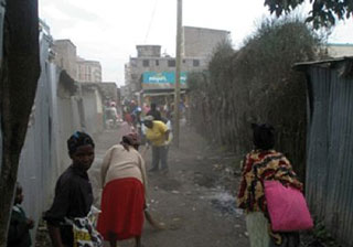 REsidents of Kariobangi collect refuse as part of the community renewal efforts backed by GPF.