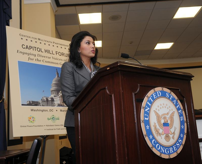 Dr. Rosa Dialal addresses the forum of faith leaders at the U.S. Capitol. [Attribution: Peter Holden]