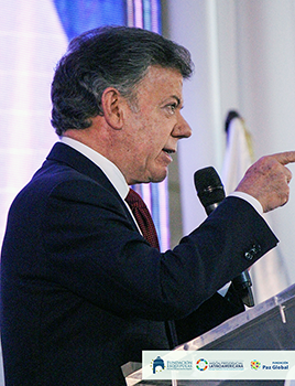 president-santos-speaking-latin-american-presidential-mission-event-guatemala