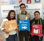 Youth pose with SDGs