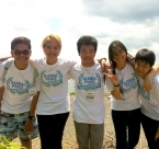 Global Peace Foundation - four Global Peace Volunteers arm in arm