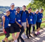 Global Peace Foundation - a group of International Young Leaders Assembly (IYLA) participants sits in front of a fence in front of a scenic overlook