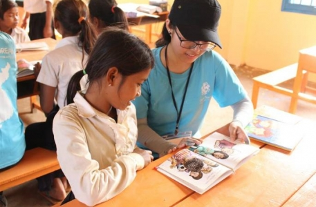 Global Peace Foundation volunteer teaches student in Cambodia