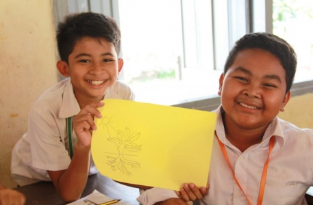 Global Peace Foundation Cambodia volunteers show their artwork
