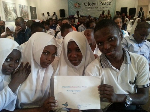 Tanzanian Youth Pose with #PeaceDay Sign at Celebration
