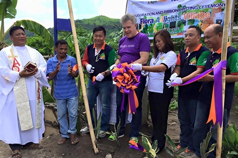 Global Peace Foundation and regional representatives cut celebratory ribbon.