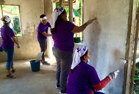 Global Peace Foundation Volunteers paint community center and school.