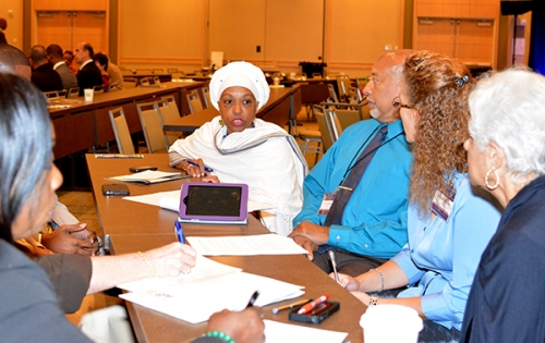 Participants conversate during Interfaith session