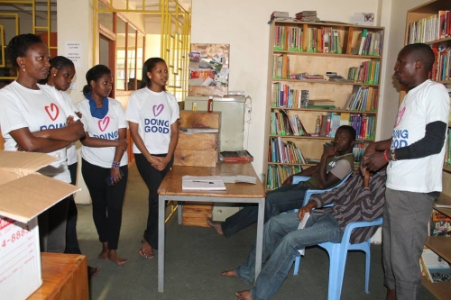 Africa Peace Service Corps Volunteers clean library in Mathare, Kenya