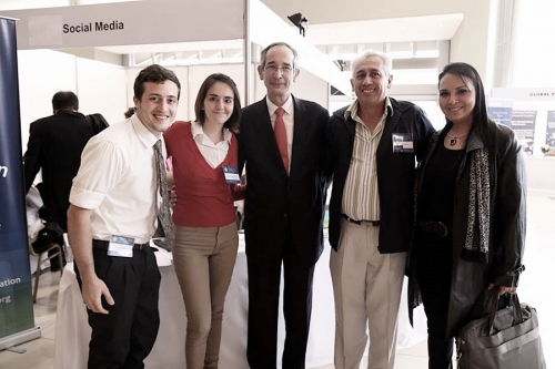 H.E. Colom and volunteers at Global Peace Convention 2014