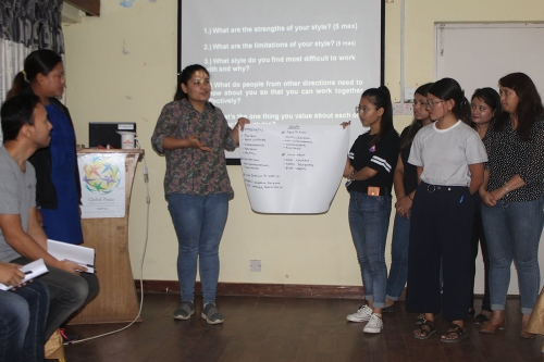 Group representatives sharing their discussion points on leadership styles