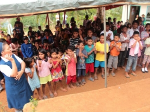 Local children at Sitio Pureg welcome the international team with song