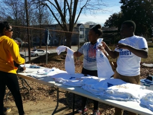 Handing out MLK Day volunteer tshirts.