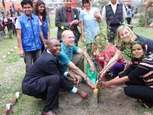 Partners plant a tree at Bagmati River clean up