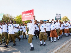 A peaceful match of youths and students, carrying various peace messages as a symbol of celebrating International Peace Day.
