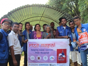 Global Peace Foundation volunteers and Okkharpauwa locals inside a transitional shelter.