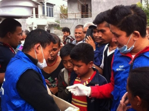 Nepali children waiting to receive food for their families