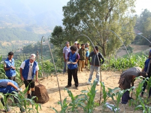 Global Peace Foundation volunteers build transitional shelters in Nuwakot.