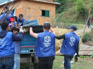 Global Peace Foundation Volunteers unload materials for transitional shelters.